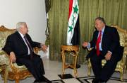 Syria's Foreign Minister Walid Moallem, left, meets with Iraqi President Jalal Talabani in Baghdad, Iraq. Talabani met privately Monday with Moallem. The Iraqi government said diplomatic relations between the two countries - severed nearly a quarter-century ago - were being restored.