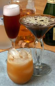 A variety of seasonally appropriate drinks will add to the food selection during the holiday season. At back left is Pomegranate-cherry Royale, foreground, Apple Orchard, and right, Vodka Espresso.
