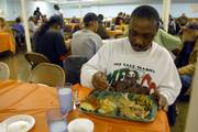 Jerry Davis eats a thanksgiving meal during LINK's 2006 Thanksgiving feast.
