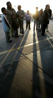 Shoppers wait outside a Kmart store at sunrise for a 7 a.m. Thanksgiving Day sale in Nashville, Tenn.
