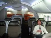 Kenneth Price, a marketing director for Boeing, sits in a mock-up of a Dreamliner cabin, which Boeing hopes will make flying a more comfortable experience. The first Dreamliner models are scheduled to be delivered to customers in 2008.