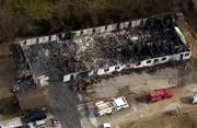 An aerial view shows what is left of the Anderson Guest House where 10 residents died and at least two dozen were injured in an early morning fire in Anderson, Mo., Monday, Nov. 27, 2006.