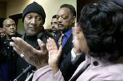 comedian Paul Mooney, second from left, said Monday that he would no longer use a racial slur in his performances. He was joined at a news conference in Los Angeles by the Rev. Jesse Jackson, center, and U.S. Rep. Maxine Waters, D-Los Angeles, right.