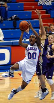 Kansas' LaChelda Jacobs tries to get a shot by Western Illinois' Sarah Miller during the second half. Kansas defeated Western Illinois 75-63 Wednesday night at Allen Field House.