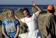 From left, Kathy Burns, Jeffrey Briar and David Sullenger participate in a laughter yoga class Wednesday on Main Beach in Laguna Beach, Calif. Briar, who founded the Laughter Yoga Institute in Laguna Beach a month ago, teaches the classes every day on the beach.
