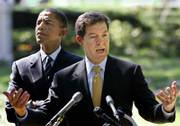 Sen. Sam Brownback, R-Kan., right, accompanied by Sen. Barack Obama, D-Ill., urges passage of Senate legislation to assist the Darfur region in Sudan in September. Brownback and Obama will be on stage today at a California megachurch.