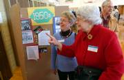 Janet Burnett Huchinson, left, and Mary Elizabether Allen, right, look at old photos of themselves and old friends during the open house at Cordley School Sunday afternoon. Both women attended Cordley School in the late 1940s and early 1950s. David Loewenstein was the lead featured artist at the event. He is also the man behind the mural of Lizzie the run away slave, who came through Lawrence on the Underground Railroad during her escape to Canada.