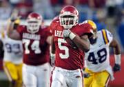 Arkansas tailback Darren McFadden (5) leaves LSU defenders behind in this file photo from Nov. 24. McFadden is one of three finalists for the Heisman Trophy.