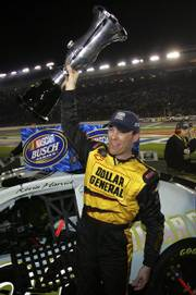 Kevin Harvick's 14 race victories in NASCAR's top two series, in addition to winning the Busch Series championship, earned him votes for best driver of the year.