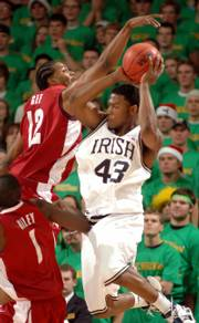 NOTRE DAME GUARD RUSSELL CARTER has his shot blocked by Alabama forward Alonzo Gee during the first half of their game. Carter scored a career-high 27 points Thursday in the Fighting Irish's 99-85 upset of the fourth-ranked Crimson Tide.