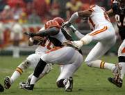 Kansas City's Trent Green (10) bumps heads with Cincinnati defensive end Robert Geathers. Green missed eight games after sustaining a severe concussion on the play.