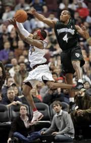 Philadelphia's Allen Iverson, left, drives to the basket on Minnesota's Randy Foye on Sunday in Philadelphia.