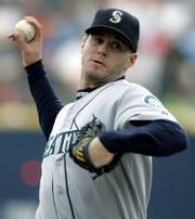Gil Meche pitches for Seattle in this September file photo. The Kansas City Royals agreed to terms with the right-hander Thursday on a five-year deal worth $55 million.