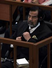 Ousted Iraqi leader Saddam Hussein sits in the dock during his trial Thursday in Baghdad, Iraq. Saddam and six co-defendants have pleaded innocent to charges of war crimes and crimes against humanity for their alleged roles in the 1987-88 military campaign against Kurds in northern Iraq.