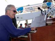 Mike Finnigan demonstrates his prowess on the Hammond B3 organ during a recent Blues Cruise performance. 