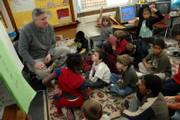 Jim Rome, a first-grade teacher at New York School, works on reading exercises with his students. Rome, who has taught at the elementary level for 34 years, including the last 11 years at New York School, is one of only a few male teachers at elementary schools in the Lawrence school district - and nationally.