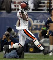 Chicago's Devin Hester celebrates his first of two kickoff returns for touchdowns. It was Hester's fifth return for a touchdown of the season, and he added his sixth in the fourth quarter of Chicago's 42-27 victory Monday in St. Louis.