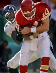 Kansas city quarterback Trent Green is sacked by Baltimore Ravens defensive end Trevor Pryce.