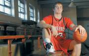 LAWRENCE HIGH SENIOR CHANCE RILEY IS A BIG MAN ON CAMPUS, and not just because of his 6-foot-5 frame. After quarterbacking the Lions to the Class 6A state quarterfinals this fall, he is now one of the leaders of the LHS boys basketball team.