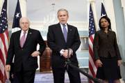 President Bush, center, Vice President Dick Cheney, left, and Secretary of State Condoleezza Rice meet with the media following their meeting at the State Department in Washington. Bush is meeting with government and military officials this week to craft a new strategy for the war in Iraq.