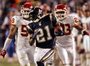 San Diego running back LaDainian tomlinson (21) leaves Kansas City's Derrick Johnson, left, and Patrick Surtain in his wake as he races 85 yards for his second touchdown. Tomlinson scored two touchdowns in the Chargers' 20-9 victory Sunday night in San Diego.