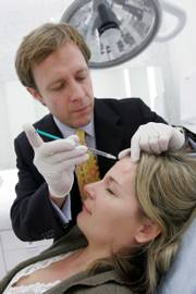 Dr. Jeffrey M. Kenkel gives patient Amy Andrade, 32, of Dallas, a Botox treatment. Medical spas like this one at Dallas' NorthPark Center are seeing rapid growth. The number in the United States has jumped from 50 in 2002, when Botox injections were approved, to about 2,500 this year.