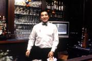 A bartender is ready to take an order at the Learned Club bar inside Kansas University's Adams Alumni Center in the early 1980s. Seven years after the closure of the upscale dining service inside the center, KU officials are considering a revival of the university club concept.