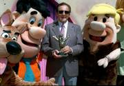 Joseph Barbera is shown with some of his famed Hanna-Barbera cartoon characters including, from left, Scooby Doo, Fred Flintstone and Barney Rubble, after he received a lifetime achievement award from the Academy of Television Arts and Sciences in September 1996. Barbera died Monday.