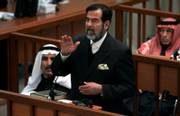 Former Iraqi President Saddam Hussein discusses prosecution evidence during his trial in Baghdad, Iraq. The chief prosecutor in Saddam's trial for genocide against the Kurds presented the most serious evidence to date Monday, implicating the deposed Iraqi leader directly in chemical attacks.