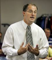 Attorney Gen-eral phill kline  talks to a men's group Sept. 16 at Topeka Bible Church. Gov. Kathleen Sebelius won't sign off on Kline's appointment as Johnson County district attorney, an unprecedented move that won't stop his appointment.