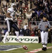 BYU running back Curtis Brown celebrates his second-quarter touchdown against Oregon during the Las Vegas Bowl. BYU won, 38-8, Thursday in Las Vegas.