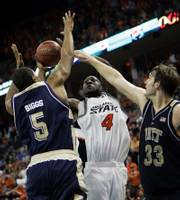 Oklahoma State's Mario Boggan, center, shoots between Pittsburgh's Tyrell Biggs, left, and Aaron Gray. Boggan scored a career-high 30 points as OSU edged Pittsburgh, 95-89 in double-overtime, on Thursday in Oklahoma City.