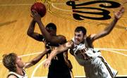 WICHITA STATE'S PHILLIP THOMASSON, RIGHT, tries to knock the ball away from Kennesaw State's Shaun Stegall, while fellow Shocker Kyle Wilson, left, defends. Thomasson and Wilson make up half the transfers who have helped Wichita State run off to a 9-0 start and a No. 8 ranking in the latest AP basketball poll.