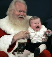 Nine-month-old Victoria Branch cries while sitting for a photo with Santa Claus Thursday at the Northpark Mall in Dallas.