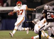 Kansas City running back Larry Johnson looks for room against the Oakland defense. The Chiefs defeated the Raiders, 20-9, on Saturday night in Oakland, Calif.
