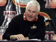 TEXAS TECH BASKETBALL COACH BOB KNIGHT laughs during his postgame press conference following a victory against Bucknell. Knight claimed his 879th victory in Saturday's 72-60 triumph, tying Dean Smith's record for Division I coaches.