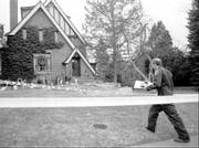 A Boulder Police detective walks to the home of John and Patricia Ramsey in Boulder, Colo., in this Friday, Jan. 3, 1997, file photo as investigators sifted through evidence in the home in which the couple's 6-year-old daughter was found murdered on Dec. 26, 1996.