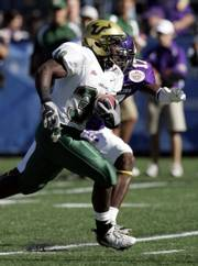 South Florida running back Benjamin Williams (30) breaks free past East Carolina defender Kasey Ross (17) for a touchdown early in the first quarter of the PapaJohns.com Bowl. Williams had two first-quarter touchdowns, leading South Florida over East Carolina, 24-7, Saturday in Birmingham, Ala.