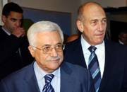 Israeli Prime Minister Ehud Olmert, right, walks with Palestinian Authority President Mahmoud Abbas, also known as Abu Mazen, prior to a meeting at Olmert's official residence in Jerusalem on Saturday. Olmert and Abbas were in a long-overdue summit Saturday, reviving hopes that peace talks can resume after years of fighting, hostility and distrust.