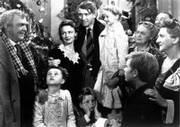 "James Stewart, center, as George Bailey is reunited with his wife, played by Donna Reed, left center, their children and Uncle Billy, actor Thomas Mitchell, left, during the final scene of Frank Capra&squot;s movie ""It&squot;s A Wonderful Life."" Stewart has his arm around child actress Karolyn Grimes, who played his daughter Zuzu."