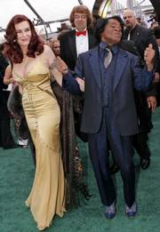 Hynie and Brown arrive for the 47th annual Grammy Awards in Los Angeles in this Feb. 13, 2005, photo. Hynie said Monday she was denied access to the home she shared with the singer and their 5-year-old son when she returned home hours after her husband died of heart failure.