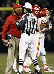 Kansas city coach Herm Edwards, left, argues with referee Pete Morelli during the Chiefs' victory Saturday in Oakland. For the Chiefs to make the playoffs, they must defeat Jacksonville, San Francisco must defeat Denver and Tennessee and Cincinnati must lose or tie. The three teams that can permanently derail the Chiefs' hopes all will play at home Sunday.
