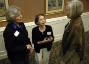 Judy Wright, left, and Jean Milstead, right, of The Fairy Godmother Fund talk with Jo Bryant, center, of the United Way. Founders, donors and friends of the fund gathered at the Smith Center at Brandon Woods on Friday afternoon.