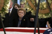 Former first lady Betty Ford is surrounded by family as she stands near the casket of her husband, former President Gerald R. Ford, Friday in Palm Desert, Calif.  Ford died Tuesday at his home in Rancho Mirage, Calif. He was 93.