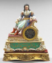 "This Paris porcelain ""Troubadour"" mantel clock was made about 1875. It is named for the elaborately costumed entertainer seated at the top. It has the typical Paris porcelain polychrome and gilded decoration."