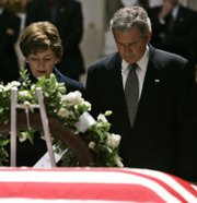 President Bush and First Lady Laura Bush pause to pay their respects by the casket of former President Gerald Ford on Monday in the Capitol Rotunda on Capitol Hill in Washington.