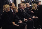 Betty Ford sits with her children and their spouses Monday as they view the casket of her husband, President Gerald Ford, in the Rotunda of the U.S. Capitol in Washington. From left are Gayle and Michael Ford, Betty Ford, Steven Ford, Susan Ford Bales and her husband, Vaden Bales, and Juliann and Jack Ford.