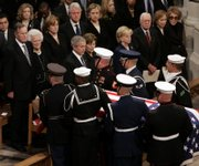 The casket of former President Gerald R. Ford is carried from Washington National Cathedral in Washington, D.C. In front row, from left, are President Bush and first lady Laura Bush; Lynne Cheney, wife of Vice President Dick Cheney; former President Carter and Rosalynn Carter; and former first lady Nancy Reagan. In the second row, from left, are former President George H.W. Bush and Barbara Bush; their daughter Doro Bush; former President Bill Clinton; Sen. Hillary Rodham Clinton, D-N.Y.; their daughter Chelsea Clinton and Secretary of State Condoleezza Rice.