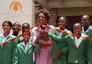 U.S. talk show host Oprah Winfrey and some of her students cut the ribbon at the official opening of the Leadership Academy for Girls School at Henley-on-Klip, South Africa. Winfrey on Tuesday opened the world-class school for poor but talented South African girls, fulfilling a long-cherished dream and a promise to her hero, Nelson Mandela.