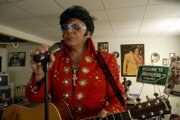"Elvis impersonator Tony Aversa, of Lawrence, has been performing for more than 20 years. He says his show is a tribute to the late king of rock &squot;n&squot; roll. ""I never had the opportunity to sit and talk to (Elvis), but the thing I know about him is that he cared about people,"" he said. His new home in south Lawrence is filled with Elvis memorabilia."